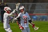 Baldwinsville Bees Connor Smith (26) is congratulated by Cole Peters (37) on his goal against the Skaneateles Lakers in Section III Boys Lacrosse action at the Pelcher-Arcaro Stadium in Baldwinsville, New York on Saturday, April 2, 2016.  Baldwinsville won 10-6.