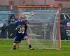 Skaneateles Lakers goalie Kyle Oschner (30) makes a save against the Baldwinsville Bees in Section III Boys Lacrosse action at the Pelcher-Arcaro Stadium in Baldwinsville, New York on Saturday, April 2, 2016.  Baldwinsville won 10-6.