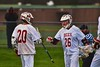 Baldwinsville Bees Ryan Gebhardt (20) gets congratulated by Connor Smith (26) on his goal against the Skaneateles Lakers in Section III Boys Lacrosse action at the Pelcher-Arcaro Stadium in Baldwinsville, New York on Saturday, April 2, 2016.  Baldwinsville won 10-6.