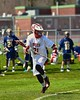 Baldwinsville Bees Brandon Mimas (21) with the ball against the Skaneateles Lakers in Section III Boys Lacrosse action at the Pelcher-Arcaro Stadium in Baldwinsville, New York on Saturday, April 2, 2016.  Baldwinsville won 10-6.