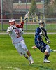 Baldwinsville Bees Ryan Gebhardt (20) winds up for a shot and goal against the Skaneateles Lakers in Section III Boys Lacrosse action at the Pelcher-Arcaro Stadium in Baldwinsville, New York on Saturday, April 2, 2016.  Baldwinsville won 10-6.