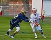 Baldwinsville Bees Ryan Gebhardt (20) with the ball against a Skaneateles Lakers defender in Section III Boys Lacrosse action at the Pelcher-Arcaro Stadium in Baldwinsville, New York on Saturday, April 2, 2016.  Baldwinsville won 10-6.