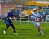 Baldwinsville Bees Charlie Bertrand (6) starts a run while being defended by Skaneateles Lakers Kevin Danaher (14) in Section III Boys Lacrosse action at the Pelcher-Arcaro Stadium in Baldwinsville, New York on Saturday, April 2, 2016.  Baldwinsville won 10-6.