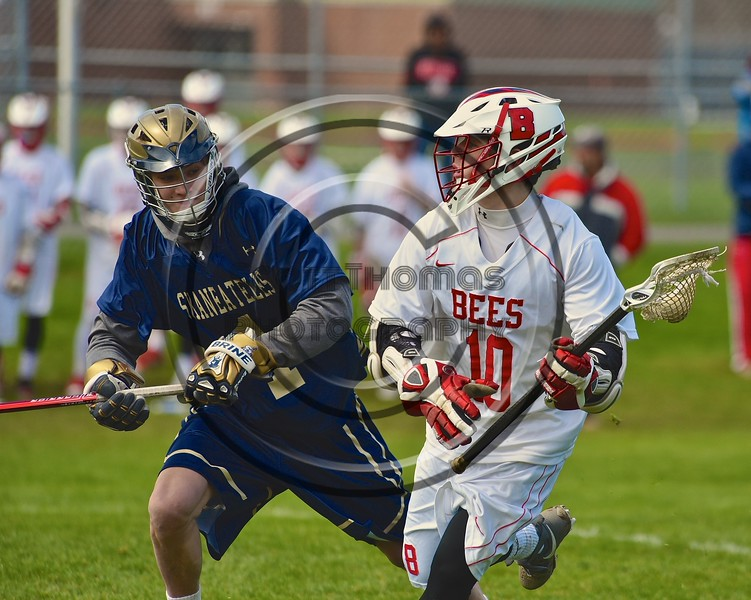 Baldwinsville Bees Dillon Darcangelo (10) cradling the ball against Skaneateles Lakers Tristan Custer (1) in Section III Boys Lacrosse action at the Pelcher-Arcaro Stadium in Baldwinsville, New York on Saturday, April 2, 2016.  Baldwinsville won 10-6.