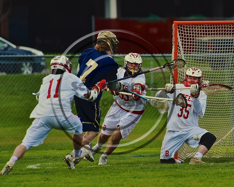 Baldwinsville Bees goalie Riley Smith (35) makes a save on Skaneateles Lakers Jack VanSlyke's (7) shot in Section III Boys Lacrosse action at the Pelcher-Arcaro Stadium in Baldwinsville, New York on Saturday, April 2, 2016.  Baldwinsville won 10-6.