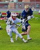 Baldwinsville Bees Cole Peters (37) avoiding a check by a Skaneateles Lakers defender in Section III Boys Lacrosse action at the Pelcher-Arcaro Stadium in Baldwinsville, New York on Saturday, April 2, 2016.  Baldwinsville won 10-6.