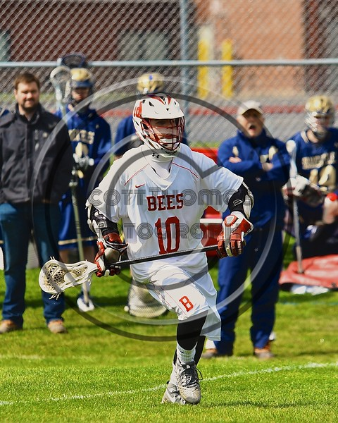 Baldwinsville Bees Dillon Darcangelo (10) with the ball against the Skaneateles Lakers in Section III Boys Lacrosse action at the Pelcher-Arcaro Stadium in Baldwinsville, New York on Saturday, April 2, 2016.  Baldwinsville won 10-6.