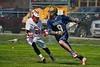 Skaneateles Lakers Reggie Buell (9) being defended by Baldwinsville Bees Kyle Pelcher (29) in Section III Boys Lacrosse action at the Pelcher-Arcaro Stadium in Baldwinsville, New York on Saturday, April 2, 2016.  Baldwinsville won 10-6.