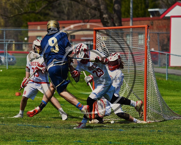 Skaneateles Lakers Reggie Buell (9) scores a goal on the Baldwinsville Bees in Section III Boys Lacrosse action at the Pelcher-Arcaro Stadium in Baldwinsville, New York on Saturday, April 2, 2016.  Baldwinsville won 10-6.