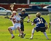 Baldwinsville Bees Charlie Bertrand (6) passing the ball past Skaneateles Lakers defenders Kevin Danaher (14) and Marc Welch (31) in Section III Boys Lacrosse action at the Pelcher-Arcaro Stadium in Baldwinsville, New York on Saturday, April 2, 2016.  Baldwinsville won 10-6.