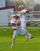 Baldwinsville Bees Peter Fiorni III (13) and Connor Smith (26) celebrate a goal by Fiorni against the Skaneateles Lakers in Section III Boys Lacrosse action at the Pelcher-Arcaro Stadium in Baldwinsville, New York on Saturday, April 2, 2016.  Baldwinsville won 10-6.