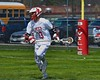 Baldwinsville Bees Peter Fiorni III (13) with the ball against the Skaneateles Lakers in Section III Boys Lacrosse action at the Pelcher-Arcaro Stadium in Baldwinsville, New York on Saturday, April 2, 2016.  Baldwinsville won 10-6.