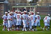 Baldwinsville Bees break the pre-game huddle before playing the Skaneateles Lakers in Section III Boys Lacrosse action at the Pelcher-Arcaro Stadium in Baldwinsville, New York on Saturday, April 2, 2016.