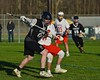 Syracuse Cougars Matt Eccles (11) protecting the ball against Baldwinsville Bees Patrick Delpha (11) in Section III Boys Lacrosse action at the Pelcher-Arcaro Stadium in Baldwinsville, New York on Thursday, April 14, 2016.  Baldwinsville won 11-6.