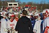 Baldwinsville Bees Head Coach Matt Wilcox talks with his players during a timeout against the Syracuse Cougars in Section III Boys Lacrosse action at the Pelcher-Arcaro Stadium in Baldwinsville, New York on Thursday, April 14, 2016.  Baldwinsville won 11-6.