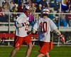 Baldwinsville Bees Matt Dickman (23) gets congratulated by Bees Dillon Darcangelo (10) after scoring a goal against the Syracuse Cougars in Section III Boys Lacrosse action at the Pelcher-Arcaro Stadium in Baldwinsville, New York on Thursday, April 14, 2016.  Baldwinsville won 11-6.