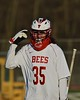Baldwinsville Bees goalie Riley Smith (35) communicating with his coach in Section III Boys Lacrosse action at the Pelcher-Arcaro Stadium in Baldwinsville, New York on Thursday, April 14, 2016.  Baldwinsville won 11-6.