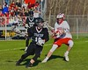 Syracuse Cougars Claflin Sterling (19) with the ball against Baldwinsville Bees defender Patrick Delpha (11) in Section III Boys Lacrosse action at the Pelcher-Arcaro Stadium in Baldwinsville, New York on Thursday, April 14, 2016.  Baldwinsville won 11-6.