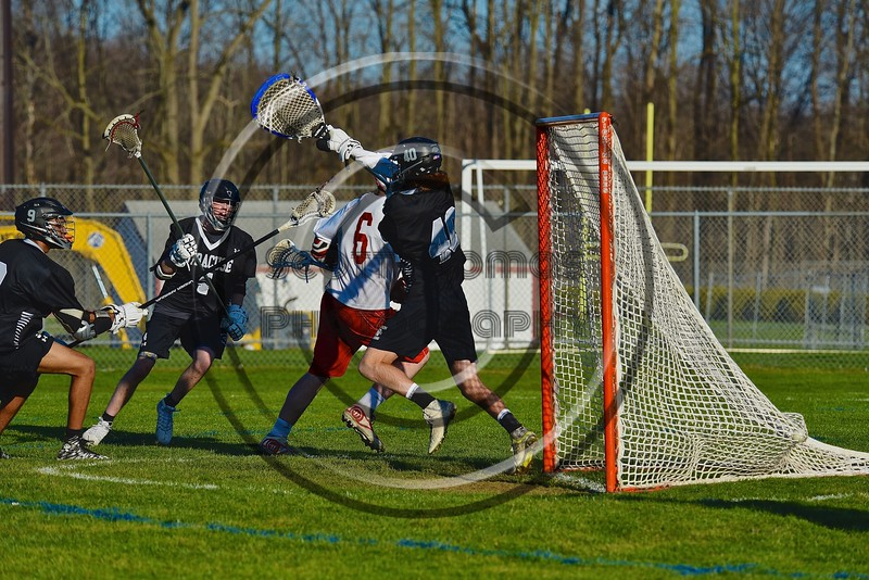 Baldwinsville Bees Charlie Bertrand (6) went behind the back for a goal past Syracuse Cougars goalie Robert Martin (40) in Section III Boys Lacrosse action at the Pelcher-Arcaro Stadium in Baldwinsville, New York on Thursday, April 14, 2016.  Baldwinsville won 11-6.
