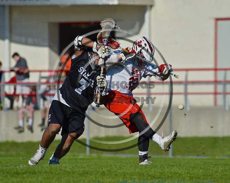 Baldwinsville Bees Evan Stolicker (32) battles for the ball with Syracuse Cougars Jakev Jackson (7) after a face-off in Section III Boys Lacrosse action at the Pelcher-Arcaro Stadium in Baldwinsville, New York on Thursday, April 14, 2016.  Baldwinsville won 11-6.