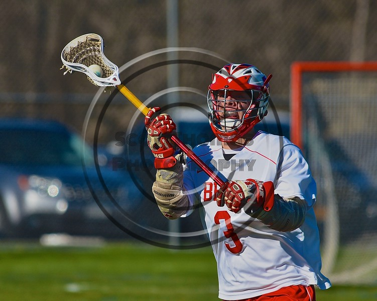 Baldwinsville Bees Ryan ingerson (3) with the ball against the Syracuse Cougars in Section III Boys Lacrosse action at the Pelcher-Arcaro Stadium in Baldwinsville, New York on Thursday, April 14, 2016.  Baldwinsville won 11-6.