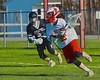 Baldwinsville Bees goalie Riley Smith (35) with the ball against the Syracuse Cougars in Section III Boys Lacrosse action at the Pelcher-Arcaro Stadium in Baldwinsville, New York on Thursday, April 14, 2016.  Baldwinsville won 11-6.