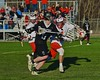 Baldwinsville Bees Patrick Delpha (11) stick checks Syracuse Cougars Matt Eccles (11) in Section III Boys Lacrosse action at the Pelcher-Arcaro Stadium in Baldwinsville, New York on Thursday, April 14, 2016.  Baldwinsville won 11-6.