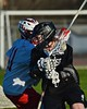 Syracuse Cougars Matt Eccles (11) working against Baldwinsville Bees Patrick Delpha (11) in Section III Boys Lacrosse action at the Pelcher-Arcaro Stadium in Baldwinsville, New York on Thursday, April 14, 2016.  Baldwinsville won 11-6.