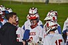 Baldwinsville Bees Head Coach Matt Wilcox talks with this players during a time out against the Syracuse Cougars in Section III Boys Lacrosse action at the Pelcher-Arcaro Stadium in Baldwinsville, New York on Thursday, April 14, 2016.  Baldwinsville won 11-6.