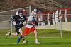 Baldwinsville Bees John Petrelli (33) brings the ball upfield past Syracuse Cougars Matt Eccles (11) in Section III Boys Lacrosse action at the Pelcher-Arcaro Stadium in Baldwinsville, New York on Thursday, April 14, 2016.  Baldwinsville won 11-6.
