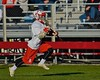 Baldwinsville Bees Ryan ingerson (3) running with the ball against the Syracuse Cougars in Section III Boys Lacrosse action at the Pelcher-Arcaro Stadium in Baldwinsville, New York on Thursday, April 14, 2016.  Baldwinsville won 11-6.