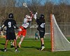 Baldwinsville Bees Charlie Bertrand (6) about to score over Syracuse Cougars goalie Robert Martin (40) in Section III Boys Lacrosse action at the Pelcher-Arcaro Stadium in Baldwinsville, New York on Thursday, April 14, 2016.  Baldwinsville won 11-6.