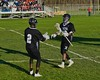 Syracuse Cougars John Elliott (22) gets congratulated by Keison Cannon (2) after scoring a goal against the Baldwinsville Bees in Section III Boys Lacrosse action at the Pelcher-Arcaro Stadium in Baldwinsville, New York on Thursday, April 14, 2016.  Baldwinsville won 11-6.