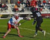 Baldwinsville Bees Matt Dickman (23) defending against Syracuse Cougars John Elliott (22) in Section III Boys Lacrosse action at the Pelcher-Arcaro Stadium in Baldwinsville, New York on Thursday, April 14, 2016.  Baldwinsville won 11-6.