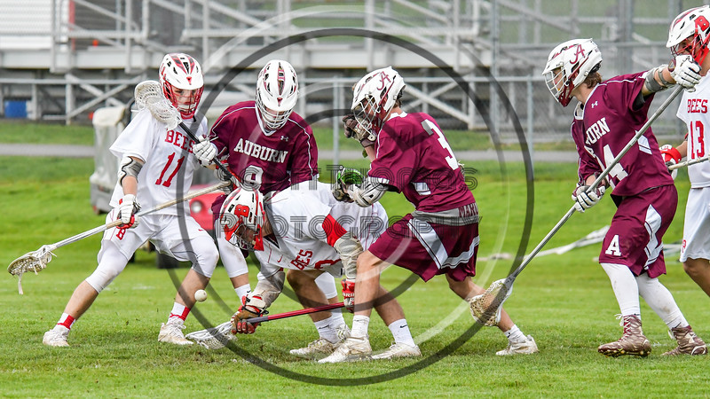 Baldwinsville Bees Ryan ingerson (3) scoops up a ground ball against the Auburn Maroons in Section III Boys Lacrosse action at the Pelcher-Arcaro Stadium in Baldwinsville, New York on Monday, May 2, 2016.  Baldwinsville won 16-6.