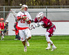 Baldwinsville Bees Connor Smith (26) gets checked by an Auburn Maroons defender in Section III Boys Lacrosse action at the Pelcher-Arcaro Stadium in Baldwinsville, New York on Monday, May 2, 2016.  Baldwinsville won 16-6.