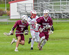 Auburn Maroons Sam Ferro (24) with the ball against the Baldwinsville Bees in Section III Boys Lacrosse action at the Pelcher-Arcaro Stadium in Baldwinsville, New York on Monday, May 2, 2016.  Baldwinsville won 16-6.