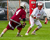 Baldwinsville Bees Patrick Delpha (11) defendng against Auburn Maroons Alex Burgmaster (4) in Section III Boys Lacrosse action at the Pelcher-Arcaro Stadium in Baldwinsville, New York on Monday, May 2, 2016.  Baldwinsville won 16-6.