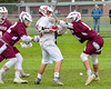 Baldwinsville Bees Dillon Darcangelo (10) has the ball knocked away from him by Auburn Maroons defenders Brady Elster (12) and Reed Chronis (14) in Section III Boys Lacrosse action at the Pelcher-Arcaro Stadium in Baldwinsville, New York on Monday, May 2, 2016.  Baldwinsville won 16-6.