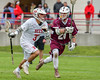 Baldwinsville Bees Cole Peters (37) running with the ball against Auburn Maroons Sam Ferro (24) in Section III Boys Lacrosse action at the Pelcher-Arcaro Stadium in Baldwinsville, New York on Monday, May 2, 2016.  Baldwinsville won 16-6.