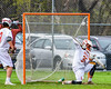 Auburn Maroons Jacob Morin (11, not pictured) scores on Baldwinsville Bees goalie Riley Smith (35) in Section III Boys Lacrosse action at the Pelcher-Arcaro Stadium in Baldwinsville, New York on Monday, May 2, 2016.  Baldwinsville won 16-6.
