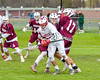Baldwinsville Bees Charlie Bertrand (6) gets checked by Auburn Maroons Braxton Murphy (17) in Section III Boys Lacrosse action at the Pelcher-Arcaro Stadium in Baldwinsville, New York on Monday, May 2, 2016.  Baldwinsville won 16-6.