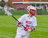 Baldwinsville Bees Brandon Mimas (21) with the ball against Auburn Maroons in Section III Boys Lacrosse action at the Pelcher-Arcaro Stadium in Baldwinsville, New York on Monday, May 2, 2016.  Baldwinsville won 16-6.