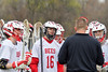 Baldwinsville Bees Dawson Giltz (16) and his fellow defensive teammates listen to their coach during a timeout agianst the Auburn Maroons in Section III Boys Lacrosse action at the Pelcher-Arcaro Stadium in Baldwinsville, New York on Monday, May 2, 2016.  Baldwinsville won 16-6.