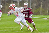 Baldwinsville Bees Mitch Warren (22) runs past Auburn Maroons Reed Chronis (14) in Section III Boys Lacrosse action at the Pelcher-Arcaro Stadium in Baldwinsville, New York on Monday, May 2, 2016.  Baldwinsville won 16-6.