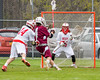Baldwinsville Bees goalie Riley Smith (35) in net against the Auburn Maroons in Section III Boys Lacrosse action at the Pelcher-Arcaro Stadium in Baldwinsville, New York on Monday, May 2, 2016.  Baldwinsville won 16-6.
