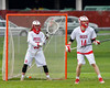 Baldwinsville Bees goalie Riley Smith (35) and David Steria (14) defending against the Auburn Maroons in Section III Boys Lacrosse action at the Pelcher-Arcaro Stadium in Baldwinsville, New York on Monday, May 2, 2016.  Baldwinsville won 16-6.
