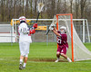 Baldwinsville Bees Ryan Gebhardt (20) shoots and scores on Auburn Maroons goalie Nikoli Biljanowski (27) in Section III Boys Lacrosse action at the Pelcher-Arcaro Stadium in Baldwinsville, New York on Monday, May 2, 2016.  Baldwinsville won 16-6.