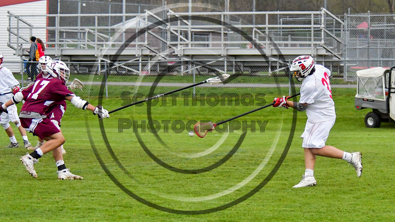 Baldwinsville Bees John Petrelli (33) fires the ball at the Auburn Maroons net in Section III Boys Lacrosse action at the Pelcher-Arcaro Stadium in Baldwinsville, New York on Monday, May 2, 2016.  Baldwinsville won 16-6.