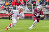 Baldwinsville Bees Mark McCabe (12) working against an Auburn Maroons defender in Section III Boys Lacrosse action at the Pelcher-Arcaro Stadium in Baldwinsville, New York on Monday, May 2, 2016.  Baldwinsville won 16-6.